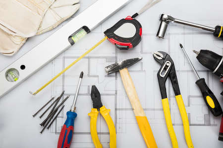 metalware: High Angle View Of Working Tools On Blueprint On Office Desk