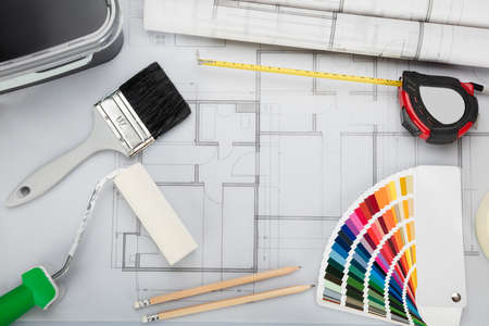 brush painting: High Angle View Of Blueprint With Tools And Equipment On Desk In Office