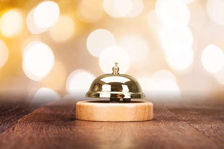 service desk: Close-up Of Service Bell On Wooden Desk