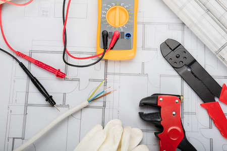 High Angle View Of Electrical Components Arranged On Plans