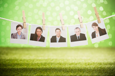 Photos Of Successful Businesspeople Hanging On Rope With Wooden Clip photo