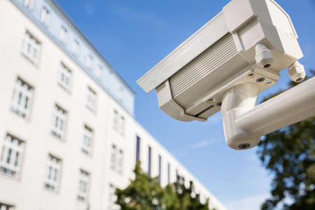 electronic survey: Close-up Of Security Camera Outside The Building For Security Stock Photo
