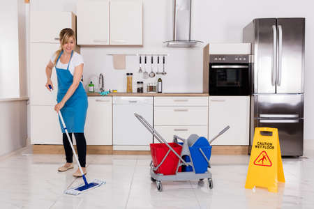 Cleaning Service Janitor Using Mop To Clean Kitchen Floor Stock Photo