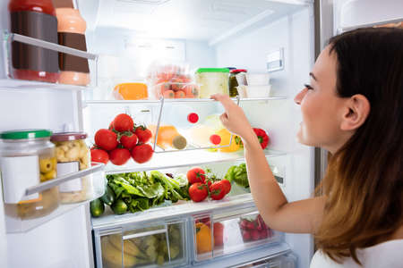 Close-up Of Young Woman Searching For Food In The Fridge Stock fotó - 69611356