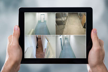 multiple: Person Monitoring Cameras Live View Of Home On The Digital Tablet