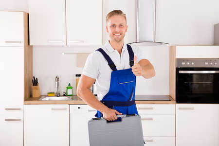 technical service: Portrait Of Happy Male Worker With Toolkit