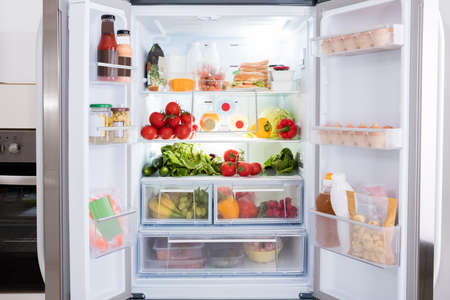 refrigerator: Open Refrigerator Filled With Fresh Fruits And Vegetable