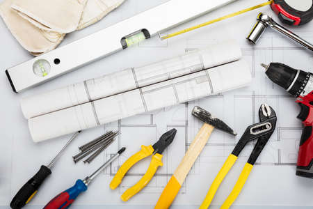 ducts: High Angle View Of Tools And Equipment Are Placed On Blueprint In Office Stock Photo