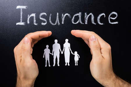 ヘルスケア: 黒板家族概念の保険の写真 写真素材