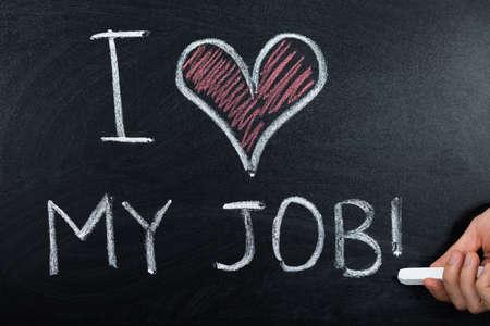 hand job: A Person Hand Showing Job Loving Concept Written On Blackboard