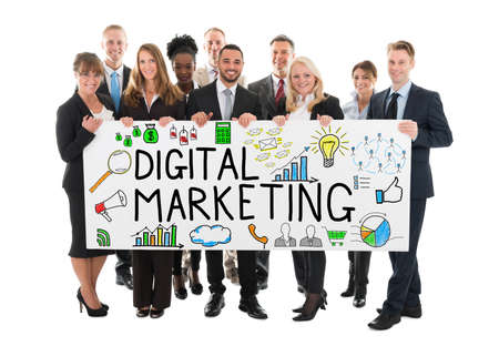 medium group of people: Large Group Of Happy Businesspeople Holding Banner Of Digital Marketing On White Background