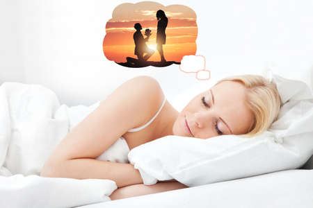 Young Beautiful Woman Dreaming Of Having Romantic Time Spending With Her Boyfriend While Sleeping photo