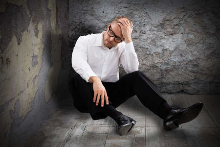 damaged: Young Worried Man Sitting In Abandoned Room