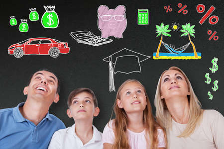 piggybank: Happy Family Dreaming Of Having A Healthy Lifestyle On Blackboard