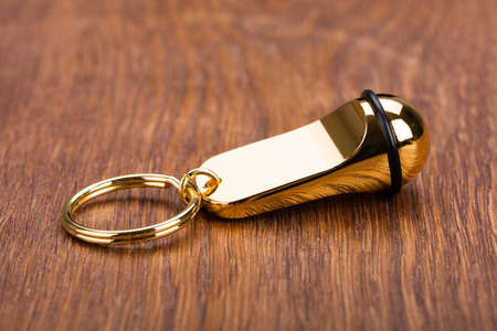 cardkey: Close-up Of Hotel Keychain On Wooden Desk