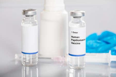 antigenic: Selective Focus Of Papillomavirus Vaccine With Medicines Stock Photo