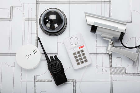 cctv: High Angle View Of Security Equipment On Blueprint In Office Stock Photo