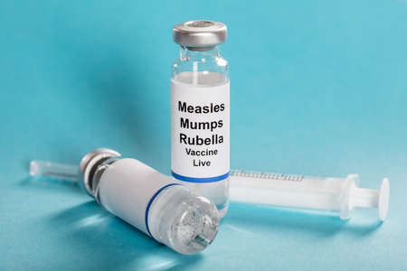 Measles Mumps Rubella Vaccine Vials With Syringe Over Turquoise Background Imagens