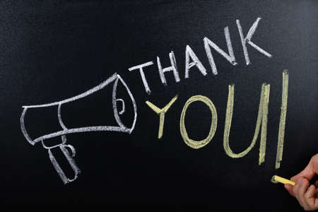Close-up Of Thank You Concept Written On Blackboard Stock Photo
