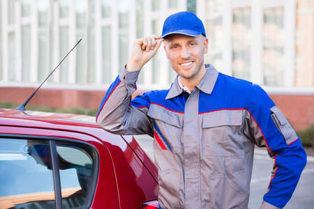 work station: Portrait Of A Happy Young Man Standing Near Car