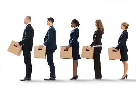 layoff: Unemployed Employees Standing In A Row After Layoff With Cardboard Boxes