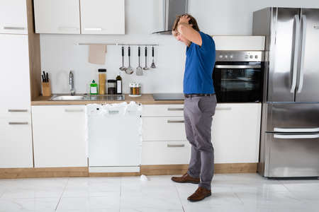 Young Man Shocked On Seeing Foam Coming Out Of Dishwasher At Home