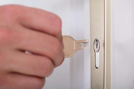 deadbolt: Close-up Of Persons Hand Holding Broken Key Inserting In Keyhole