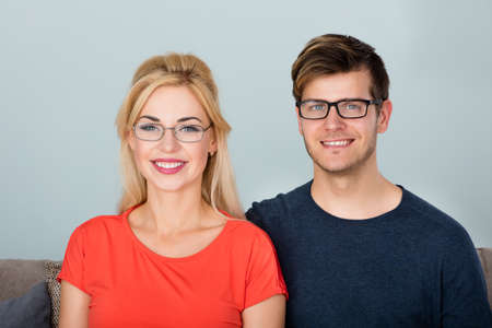 spectacle: Portrait Of Young Smiling Couple Wearing Glasses Stock Photo