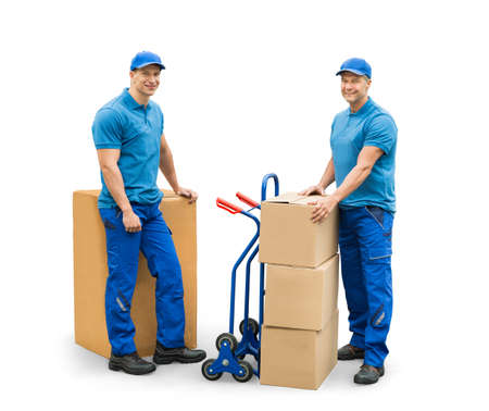Two Courier Men Standing With Cardboard Boxes On White Background Stock Photo
