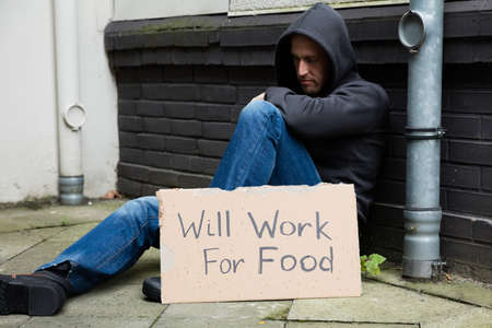 willing: Sad Unemployed Man In Hood Willing To Work For Food