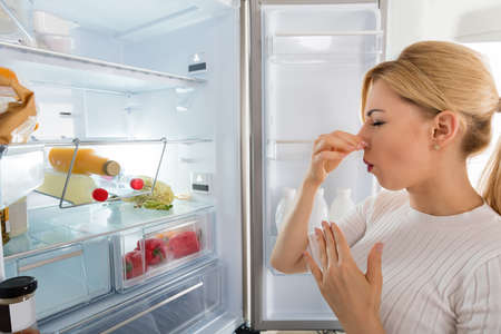 tainted: Close-up Of Young Woman Recognized Bad Smell Coming From The Refrigerator