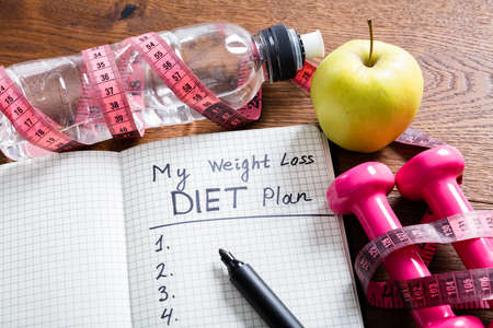 Close-up Of A Weight Loss Concept On Wooden Desk Stock Photo
