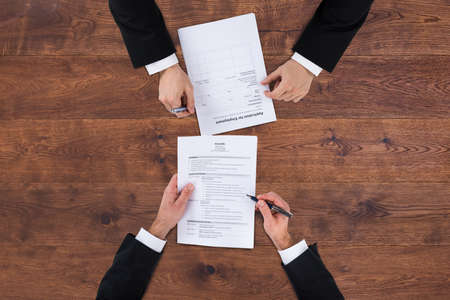 applicant: High Angle View Of A Businessman Conducting An Employment Interview Stock Photo