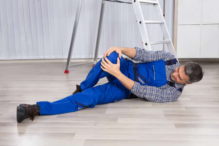 suffered: An Injured Man Suffered From Leg Pain While Lying On Hardwood Floor Stock Photo