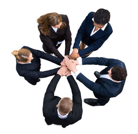 businesspeople: High Angle View Of A Businesspeople Stacking Hands Together On White Background