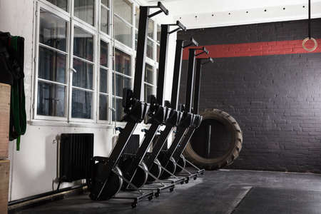 machines: Row machines Standing In An Empty Gym Stock Photo