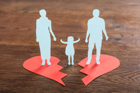 Close-up Of A Family Paper Cut On Broken Heart At Wooden Desk Stock Photo - 73495332