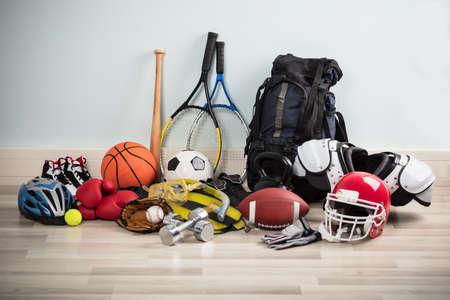Photo Of Various Sport Equipments On Hardwood Floor