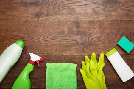 High Angle View Of A Cleaning Product And Tool On Wooden Desk Archivio Fotografico