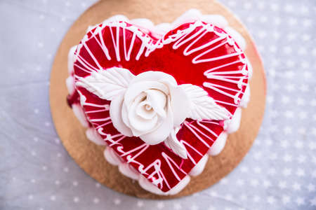 Cake In The Heart Of Shape With White Rose Stock Photo