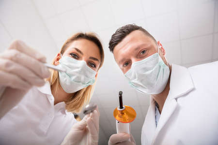 low perspective: First Person View Of Male And Female Dentist In A Clinic