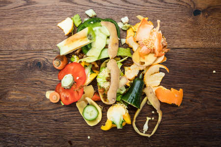 Elevated View Of Vegetable And Fruit Peelings On Wooden Table Stock Photo