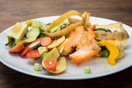 Waste Based Cooking. Vegetables And Fruit Peelings On White Plate Stock Photo