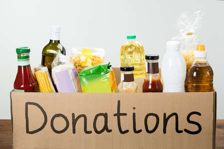 Close-up Of A Donation Box With Various Food Items In It