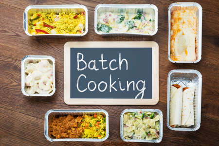 Batch Cooking Text Written On Slate With Take Away Dishes In Foil Container On Table