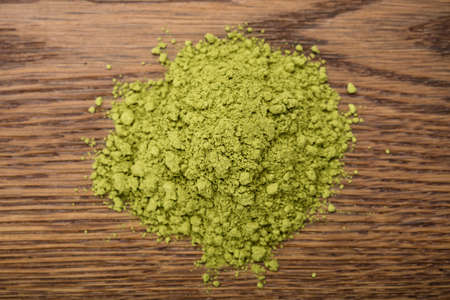 green powder: Photo Of Matcha Tea Powder On Wooden Table