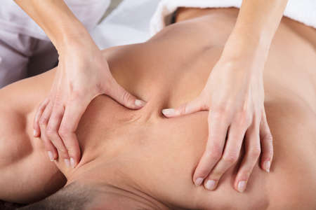 Man Lying On Front Getting Message At Spa
