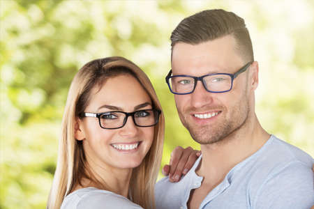 Happy Young Couple With Stylish Eyeglasses Outside Stock Photo