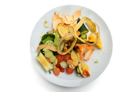 Close-up Of Fresh Vegetable And Fruit Peelings On White Plate Stock Photo