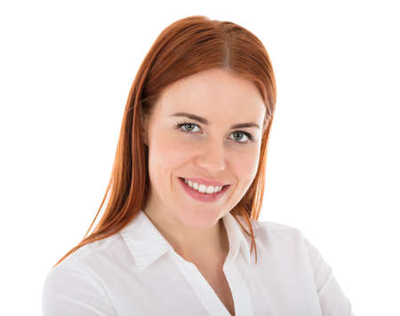 Portrait Of Happy Young Hostess In Front Of White Background Stock Photo